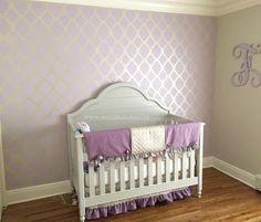 A DIY stenciled purple and cream stenciled nrusery accent wall using the Rabat Allover Stencil from Cutting Edge Stencils. http://www.cuttingedgestencils.com/moroccan-stencil-pattern-3.html