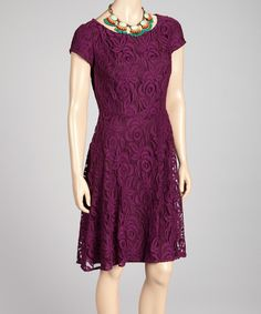 Crafted with rich color, this piece features a lovely floral lace overlay to sweeten any feminine look while the exposed back zipper adds a hint of stylish edge.Necklace not includedMeasurements (size 6): 38'' long from high point of shoulder to hemShell: 80% cotton / 20% nylonLining...