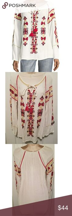 """Flash SALE Raga Embroidered Tassel Tunic NWT small New with tags embroidered Tassel Tunic in eggshell color by Raga. Size small. 100% viscose. Approx. 27"""" in back, 22"""" in front. RAGA Tops Tunics"""