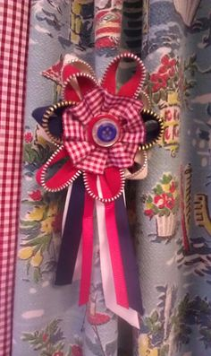a vintage rosette made rom zips! I keep it on my curtains!