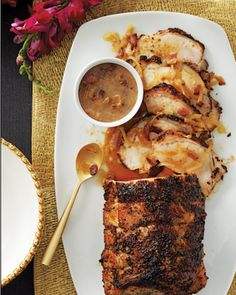 Gourmet Thanksgiving feast with roast pork loin with bacon-cider gravy