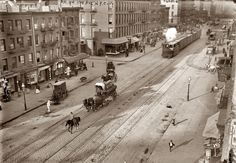 """Manhattan streetscape of rail cars at West 26th Street and Eleventh Avenue, known as """"Death Avenue"""" for the many pedestrians killed along the New York Central's freight line there. 1910. Removal of the street-level tracks commenced on December 31, 1929."""