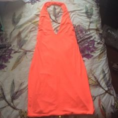 Coral Party Dress Size small. Deep V neck and low cut back. With a sexy pop of color this garment is perfect for any club or party you're looking to attend. Sexy gold zipper down the back allows for easy on easy off. Wore it once in Vegas. NO TRADES. Check out my bundle discount ☺️ Foreign Exchange Dresses Mini