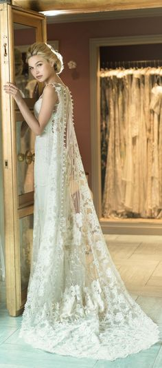 Floral embroidered tulle and lace wedding cape and gown by Claire Pettibone https://couture.clairepettibone.com/collections/the-gilded-age-wedding-dresses/products/whitney