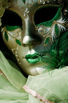 """Venice in green - Masks permit the imaginative experience of """"what it is like"""" to be transformed into a different identity"""