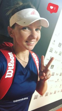 Simona taking a selfie after her win in Madrid