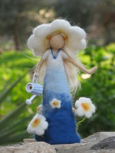 Needle felted daisy lady - waldorf inspired. $52.00, via Etsy.