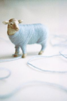 Cutie sheep wrapped up in pale blue wool