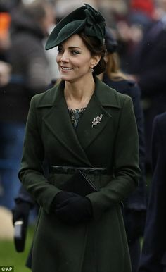 The Duchess looked sophisticated in a calf-length green coat and matchting hat...