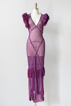 1930s sheer purple striped ruffle gown features large ruffled sleeves, a deep v-neck, and ruffle detail on the skirt. Is cut on the bias and hugs the body for an ultra flattering fit.  (For the boudoir or evening wear with a slip.)