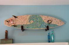 Wave mosaic on surfboard by Marianas Mosaics