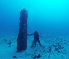On 10th anniversary of Navy deal to stop test-blasting on Vieques, a deep-diving fisherman is seen on the sea floor by an unexploded bomb off the coast. At the current cleanup rate, the Navy says, it will take until 2025 to remove all the environmental damage left by more than 60 years of target practice.