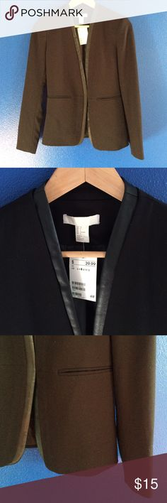 NWT H&M blazer Black open front Leather lapel 6 New With Tags H&M black blazer. Open front style. Has faux leather detail along lapel around neck to the edge of bottom. 2 faux pockets in front. Perfect condition. Never worn. Size 6 H&M Jackets & Coats Blazers