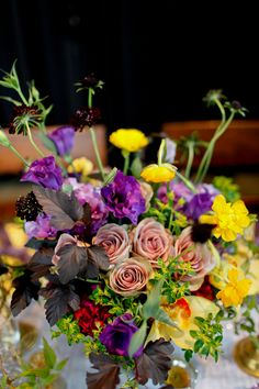 Floral wedding centerpiece - Photo Source • Dallas Curow Photography