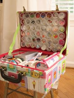 Craft suitcase! (Cookie sheet behind paper so magnets will stick and hold on little containers.)