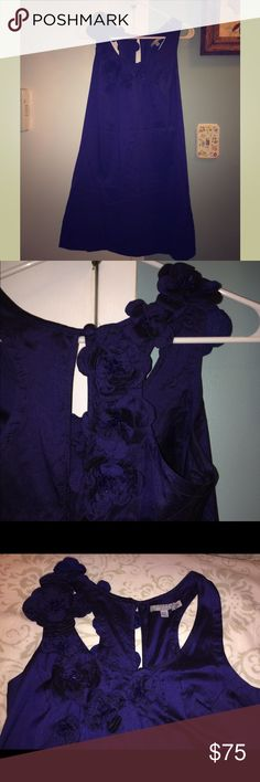Royal Blue Calypso Dress Below the knee. Flowers begin in the front of the dress and down the middle of the back. Tag is falling off. Condition is still great. Calypso St. Barth Dresses Midi