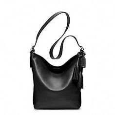 To hold ALL my stuff! Coach Legacy Collection vintage inspired handbags.