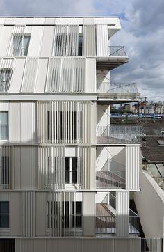 Sliding shutters cover Dietmar Feichtinger Architectes' Parisian apartments