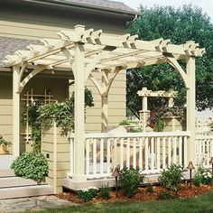 A plain wooden builder's deck comes alive with a stately pergola. Not only does the new structure add style, but it also helps to provide shade.
