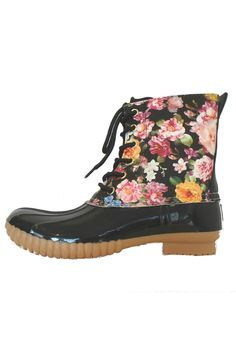 "A classic duck boot style infused with a touch of whimsy! Black patent look boot that will keep the water out and your feet dry when you feel the urge to splash through those rainy spring puddles! The classy black color will go with any outfit while the rose printed shaft is positively feminine and whimsical when paired with a POP! of pink or orange on a handbag. We absolutely LOVE them with a pair of jeggings and flowy top. Fit runs a bit small (short) half sizes order up heel height: 1/2""…"