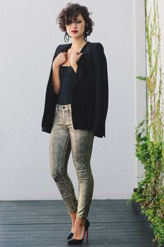 Karla Deras of Karla's Closet shows off her tousled curls and shiny 7FAM skinnies.