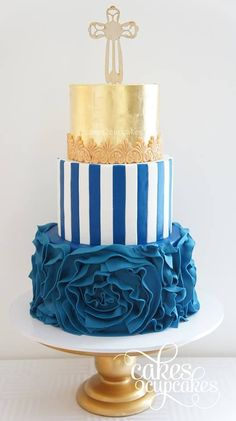 blue and gold multi tiered wedding cake.