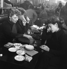 Edith Perret et Eddie de Ré à,  Saint Germain des Prés, 1950 by Robert Doisneau