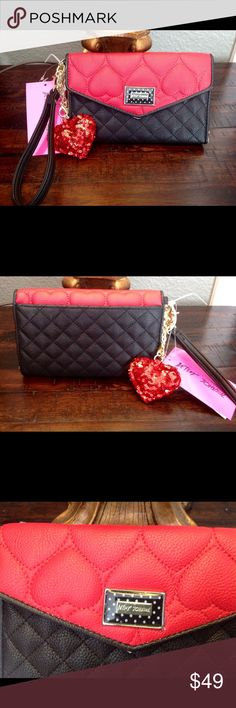 Betsey Johnson Red Black Wallet Brand New Betsey Johnson Wallet.  Red and black.  Inside is gold colored faux leather.  Red cushion heart design on the front.  Enough room for 12 credit cards, ID, and side pockets for misc.  check book area.  Perfect Christmas present. Comes with free sequin heart accessory. Betsey Johnson Bags Wallets