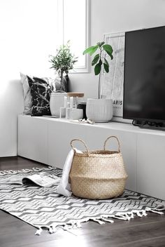 Minimalist black and white decor looks great with pops of green from real plants.