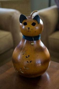 Tabby is honey in color and comes with an electric light. Approximately 8 inches in diameter.