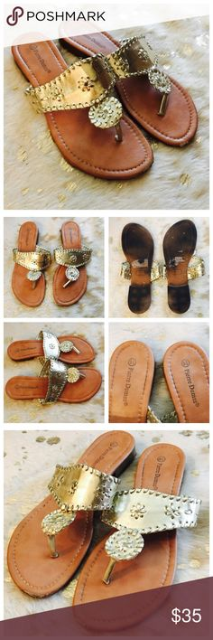 Gold Sandals Worn with signs of wear on front bottoms. See photos. Really pretty and comfortable gold sandals! Designed like Jack Rogers! Synthetic upper with rubber soles and stitching accents. Pierre Dumas Shoes Sandals