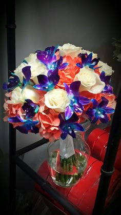 Coral Hydrangea,  Blue  Orchids  and White Roses : Designed by Ms. Scarlett's  Flowers