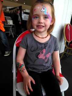 Such a Cutie Pie,fashioning her new airbrush tattoo rainbow fairy.