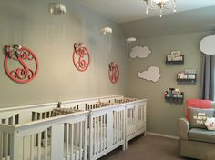 Triplet toddler nursery in gray, white and coral with a cloud theme. Reading nook with wall shelves to store books out of busy toddler reach. Triplet nursery , toddler bedroom