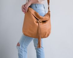 Mayko Basic | Leather Hobo Bag l Camel Leather  * Italian soft leather * Stylist Design * Different Colors / 7 Color options / see options at last photo * Perfect bag for Daily Use! * Very comfortable & Light * Fast & easy to Clean * Fair price * Can be the perfect Gift for You or for Your Loved ones ♥  <<< Bag Feature - Adjustable Leather Strap - One Large & spacious compartment - Leather Tassel Closure with a Metal Ring - Unlined  - Height : Cm /  - Width Top : Cm /  - Width Bottom : Cm…