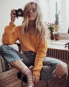 mustard color sweaters | distressed light denim jeans | striped high socks | blonde waves | small cameras | bright lipstick | fall