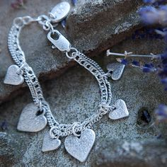 Tutti & Co Elsa Urban Heart Silver Charms Bracelet | lizzielane.co.uk £17