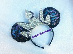 The little mermaid Ursula Minnie ears poor unfortunate souls with rhinestone crown. Check out more ears on my instagram page @lizzyzbowtique or my etsy shop www.etsy.com/shop/lizzyzbowtique