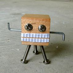 A tall mini robot sculpture I made out of wood and screws. Beach Crafts, Home Crafts, Fun Crafts, Rustic Wood Crafts, Diy Robot, Tin Art, Scrap Wood Projects, Wood Creations, Wood Toys