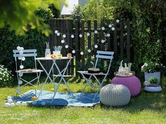 This versatile garden set comprises two, white chairs paired with a functional bistro table, perfect for a backyard or balcony in any design scheme.