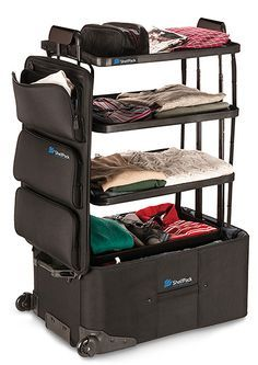 A suitcase with built-in shelves! I need one of these.. It will be so helpful when packing our clothes:)
