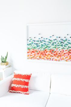Easy wall art made with chicken wire and paper!