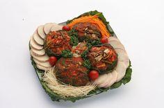 보쌈김치(bossam-kimchi) / Wrapped Kimchi  Royal court kimchi wrapped around oyster, squid, Korean pear, and radish.