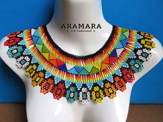 Dimensions Necklaces length is 18.2 inches (48.26 cms) from point to point Necklaces width is 4 inches (10.16 cms) Necklaces hanging length is 11.5 inches (29.21 cms) from point to point Earrings length is 2.6 inches (6.60 cms) The Huichol represent one of the few remaining indigenous