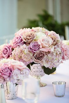 Low Rose & Hydrangea Arrangement in Silver Mercury Vessel | Photography: Full Spectrum. Photography. Read More: http://www.insideweddings.com/weddings/a-modern-san-diego-hotel-wedding-with-purple-sparkling-details/672/