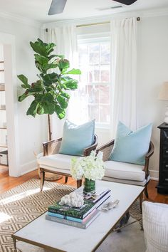 neutral coastal living room before and after on holycitychic.com with @shopcandelabra coffee table and chest, fiddle leaf fig, cane chairs, and diamond weave sisal rug