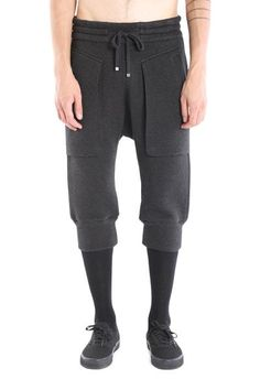 """The cropped sweatpant by Helmut LangDetailsEncased drawstring waistband Banded hem at the knee Measurements taken from a size S Waist circumference relaxed 31"""" Front rise 16 1/4"""" Inseam 15 3/8""""Infiltrated Jersey Double layer knit with allover perforation, for texture and breathability 78% Cotton, 22% Polyester Dry cleanColor: Black  SizingTrue to size.Alic is 6'1"""" and 160 lbs and is wearing a medium."""