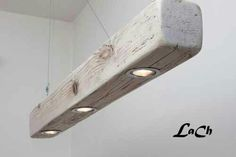 Wooden Eyes: barn / upcycle / repurposed / hanging / suspended / clean / simple / wooden beam / spotlights CREDIT: Lach (clipit)