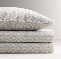Ikat sheet set for top bunk (so you can see the fitted sheet on top to match bottom comforter/quilt) from RH Baby & Child in Aqua