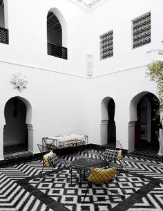The exotically tiled courtyard of Samuel & Caitlin Dowe-Sands' 18th century house in Marrakesh. The Dowe-Sands run hand made Moroccan tile company,Popham Design.